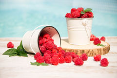 Sweet raspberries in bowl on wooden table. Close up, top view Royalty Free Stock Photography