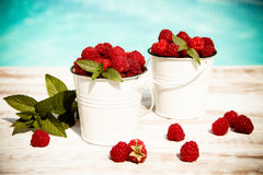 Sweet raspberries in bowl on wooden table. Close up, top view Stock Image