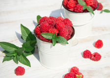 Sweet raspberries in bowl on wooden table. Close up, top view Royalty Free Stock Photo
