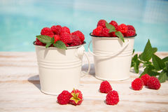 Sweet raspberries in bowl on wooden table. Close up, top view Royalty Free Stock Image
