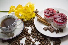 Sweet raspberry cake with coffee beans. Berry cheesecake on plate with aroma ingredients; photo with copy space for text Stock Photo