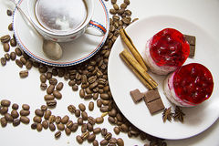 Sweet raspberry cake with coffee beans. Berry cheesecake on plate with aroma ingredients; photo with copy space for text Stock Photos