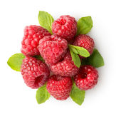 Sweet raspberry with green leaves. Isolated on white Royalty Free Stock Image