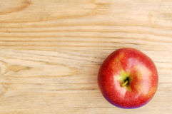 Sweet red apple fruit on wood table Stock Photo