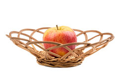 Sweet red apple in wicker Stock Photography