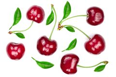 Sweet red cherries with leaves isolated on white background. Top view. Flat lay pattern royalty free stock photos