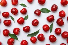 Sweet red cherries and leave. S on white background Royalty Free Stock Image