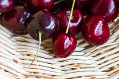 Sweet Red Cherries. On a woven basket Stock Images