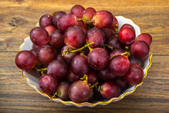 Sweet red grapes in a bowl Stock Photo