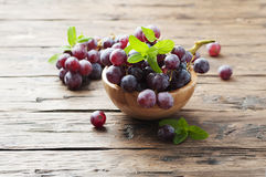 Sweet red grapes on the wooden table Royalty Free Stock Image