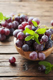 Sweet red grapes on the wooden table Stock Photo