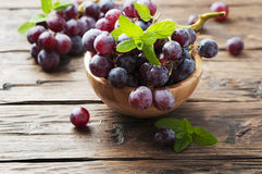 Sweet red grapes on the wooden table Stock Photos