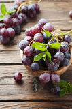 Sweet red grapes on the wooden table Royalty Free Stock Images