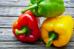 Sweet red green yellow bell pepper on wooden background Royalty Free Stock Photography