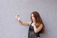 Sweet red-haired girl making faces royalty free stock images