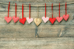 Sweet red hearts on wooden background. Valentines Day. Sweet red hearts hanging on wooden background. Valentines Day concept Royalty Free Stock Images