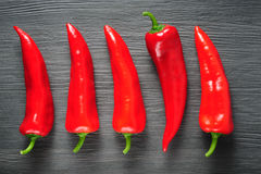 Sweet red Kapia peppers on a dark shale stone background Royalty Free Stock Images