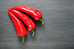 Sweet red Kapia peppers on a dark shale stone background Stock Image