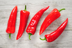 Sweet red Kapia peppers on a white wood background Stock Images