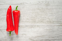Sweet red Kapia peppers on a white wood background stock photo