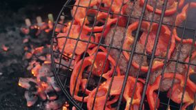 Sweet red pepper on the grill. He is smoked on the bbq. A great vegetarian dish stock footage
