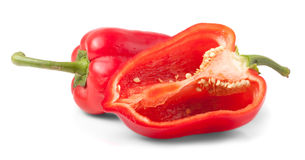 Sweet red pepper and half cut Royalty Free Stock Photo