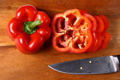 Sweet red pepper sliced on hardboard Royalty Free Stock Photos