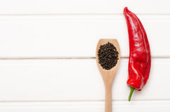 Sweet red pepper on white wooden boards.  Stock Photography