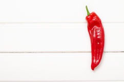 Sweet red pepper on white wooden boards.  Royalty Free Stock Photography