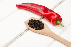 Sweet red pepper on white wooden boards.  Stock Image