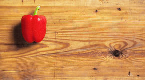 Sweet red peppers on a decorative board. Royalty Free Stock Photos