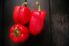 3 sweet red peppers Stock Photos