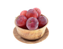 Sweet red plum in a wooden bowl Stock Photography