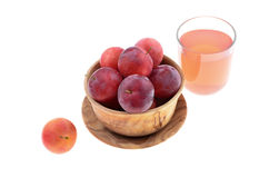 Sweet red plum in a wooden bowl Royalty Free Stock Photo