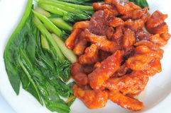 Sweet Red Pork with Kai-Lan. That is Chinese food style in Restaurant Stock Photo