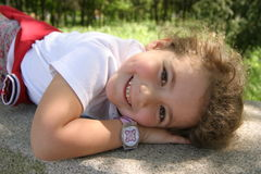 Sweet resting. Little girl resting ona bench Royalty Free Stock Image