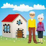Sweet Retirement House. Senior couple standing in front of sweet old style retirement house Stock Photography