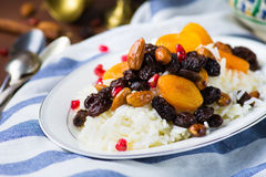 Sweet rice plov with dried fruits and nuts Royalty Free Stock Photo