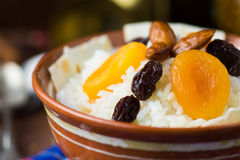 Sweet rice plov with dried fruits and nuts Royalty Free Stock Photos