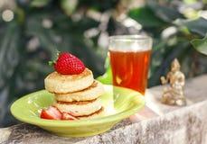 Sweet ricotta pancakes with tea in the garden stock photos