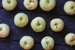 Green apples on the old vintage table Royalty Free Stock Photography