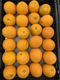 Sweet ripe oranges fruits on market close up stock photo