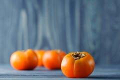 Sweet ripe persimmons Stock Image