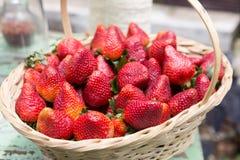Sweet ripe strawberries in wicker basket Stock Photos