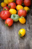 Sweet ripe tomatoes on wooden table Stock Image
