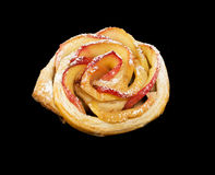 Sweet roll with apples in the form of roses on black  background Stock Image