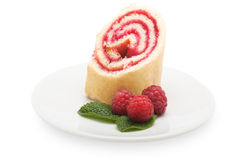 Sweet roll cake with raspberry jam and berries, isolated on a wh Stock Photo
