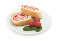 Sweet roll cake with raspberry jam and berries,  on a wh Royalty Free Stock Image