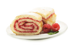 Sweet roll cake with raspberry jam and berries,  on a wh Stock Image