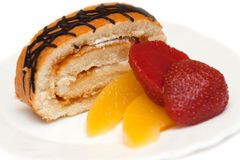 Sweet roll with peaches and strawberries Stock Image